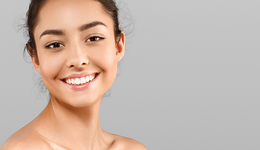 Woman smiling with acne free skin