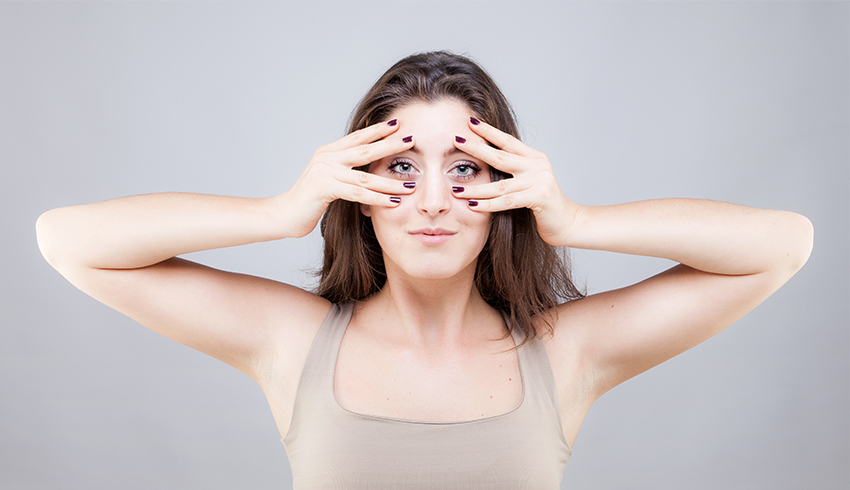woman doing face yoga