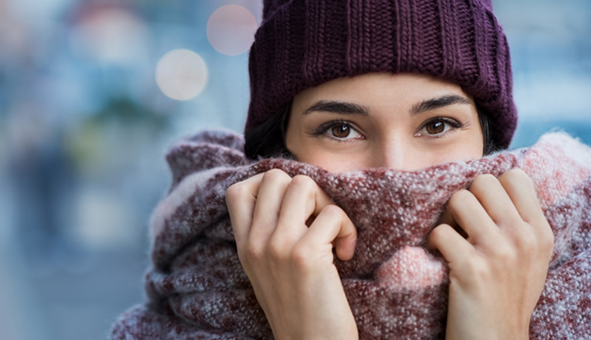 Woman snuggling into scarf