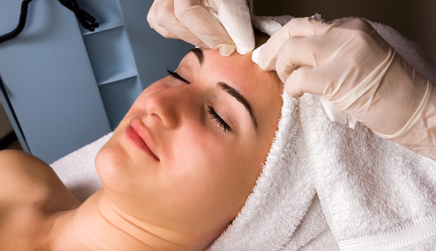woman at spa getting an acne facial