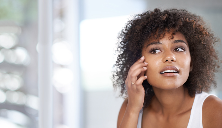 Woman touching right side of her face near under eye area