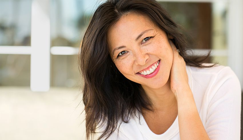 Woman smiling with clear skin and small pores