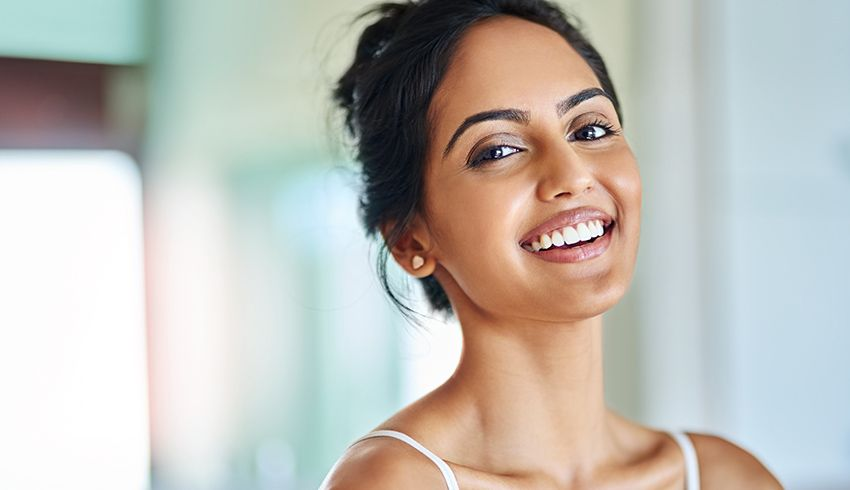 Woman smiling with clear skin