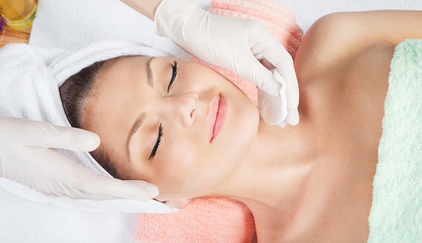 Woman receiving professional lactic acid peel