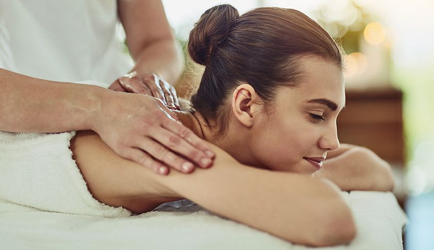women getting spa body treatment