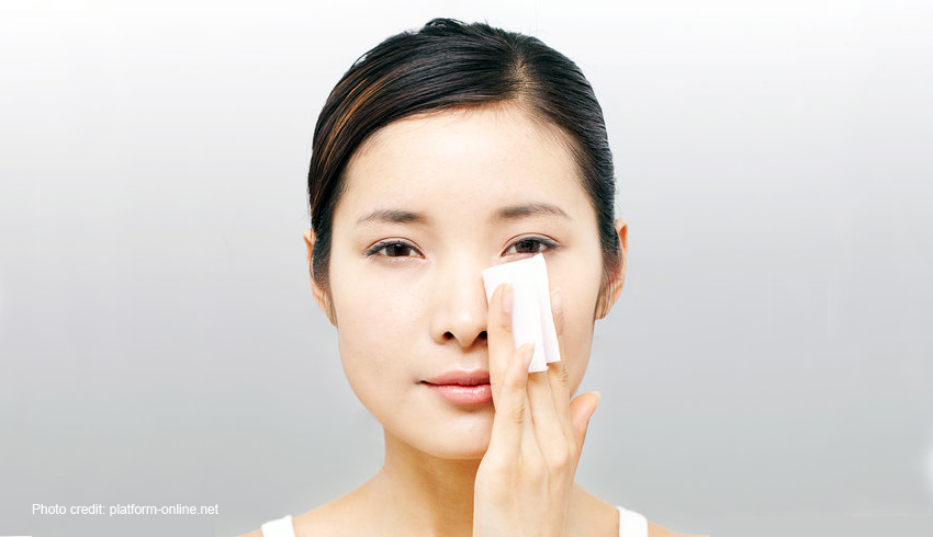 woman blotting face