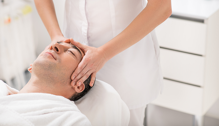 Man receiving a spa facial