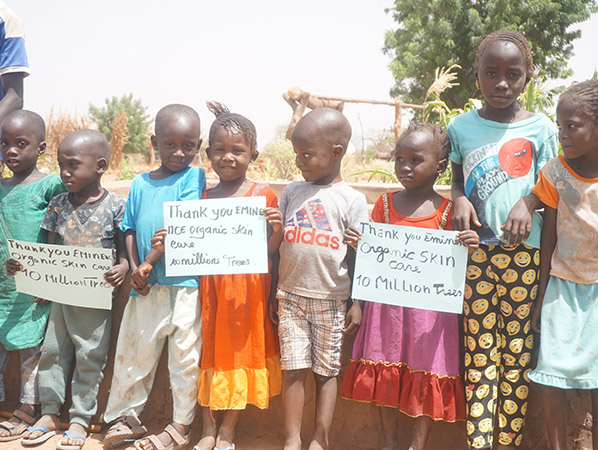 Forest Garden Project kids with 10 million trees signs