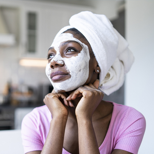 Black Woman Doing A Facial