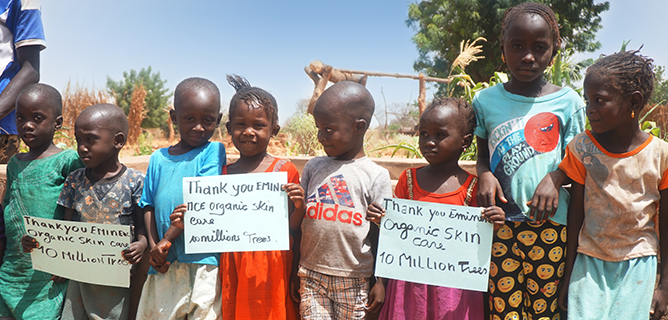 Children in Senegal thanking Eminence Organic Skin Care for planting 10 million trees