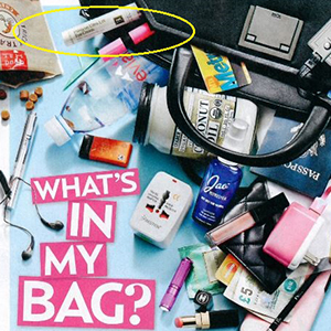 US Weekly feature showing Eminence Organics Hibiscus Ultra Lift Eye Cream in Archie Panjabi's bag