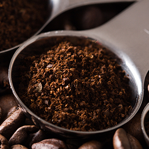 Spoonful of coarse coffee grounds