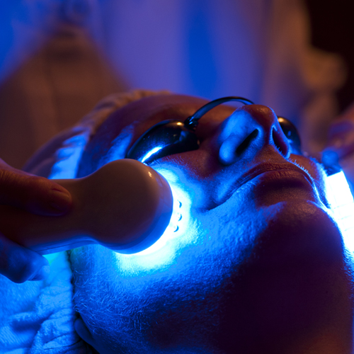woman in spa receiving LED facial