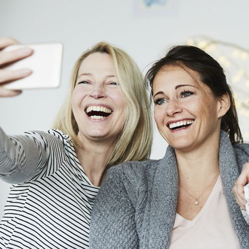 two women in 40s taking selfie
