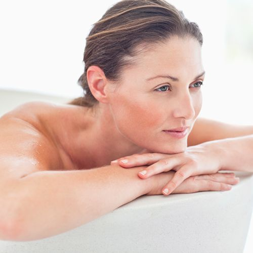 Woman relaxing in bath tub