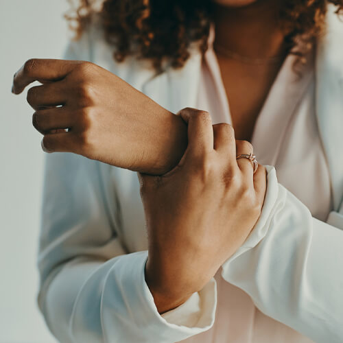 woman holding her aching wrist