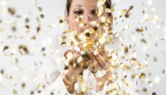 Woman blowing confetti