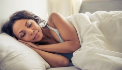 Woman sleeping in Eminence Organics overnight face treatment