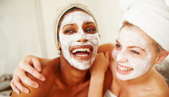 Two women with facial masks on