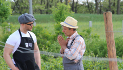 Eminence Organics' President and organic farmer in discussion