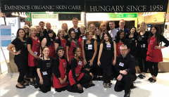 Team of staff and estheticians at an Eminence Organics tradeshow booth