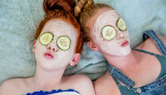two girls with facial masks on