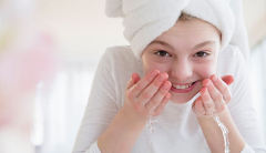 preteen girl washing her face