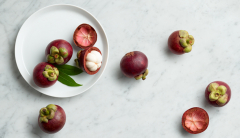 Mangosteens on a plate and marble counter